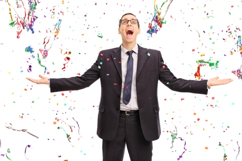 Overjoyed businessman with confetti around him